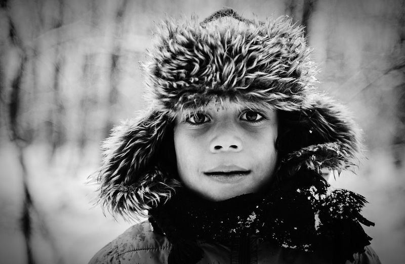 Close-up portrait of boy wearing fur hat