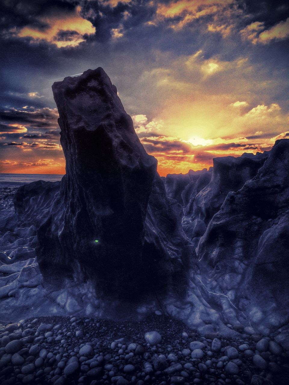 Frozen Rock On Shore During Sunset