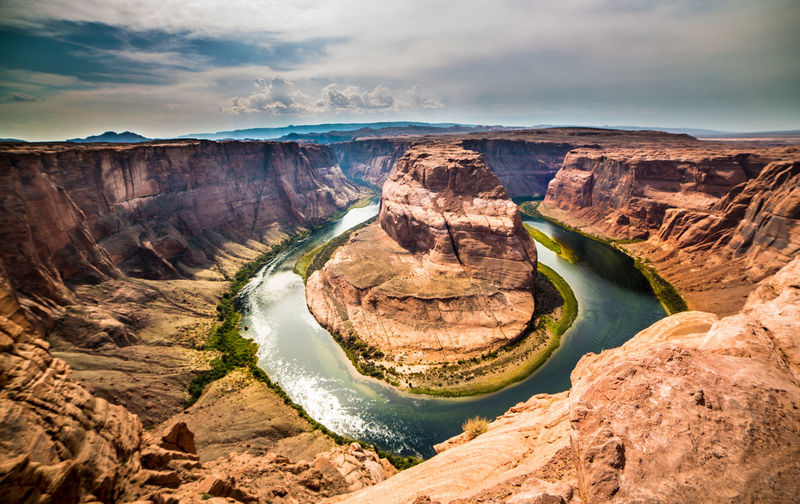 A Classic View of Horseshoe Bend on the Colorado River, Horseshoe Bend Colorado River Sandstone Rock Eroded Geology River Cloud - Sky Travel Destinations Grand Canyon National Park Roadtrip Vanlife Page Arizona Red Orange Color Afternoon Shadow Light And Shadow Rock Formation Travel Physical Geography Power In Nature Beauty In Nature Scenics - Nature