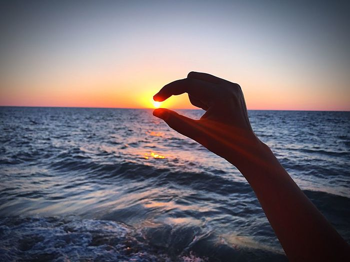Alexandria Sunset Sea Horizon Over Water Sun Beauty In Nature Clear Sky Human Hand Water Orange Color Scenics Nature Silhouette One Person Sky Real People Beach Lifestyles Tranquil Scene Outdoors Women Hold Sun