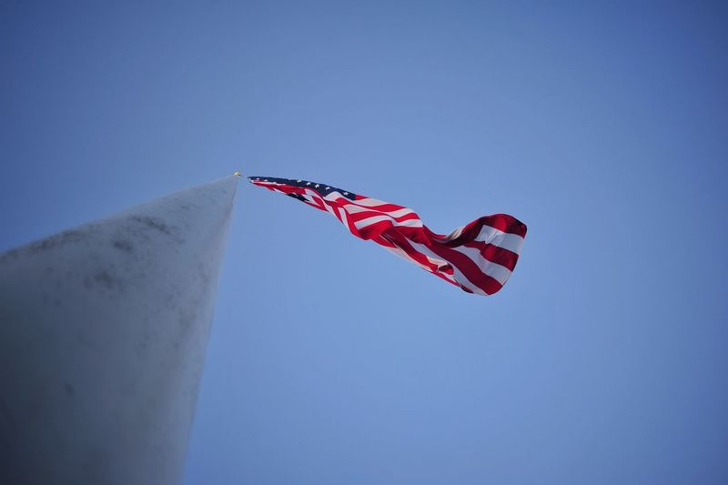 Blue Clear Sky Day Flag Flying Low Angle View No People Outdoors Patriotism Pride Red Sky Stars And Stripes Waving Wind