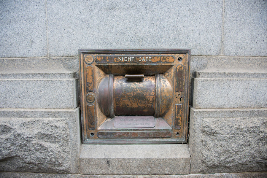 Old night safe on bank building exterior in Perth, Western Australia. Antique Bank Banking Box Bronze Building Exterior Built In Convenient Deposit Deposit Box Drop Box Finance Finance And Economy Metal Money Night Old Old-fashioned Outside Retro Safe Secure Slot Vintage Wall