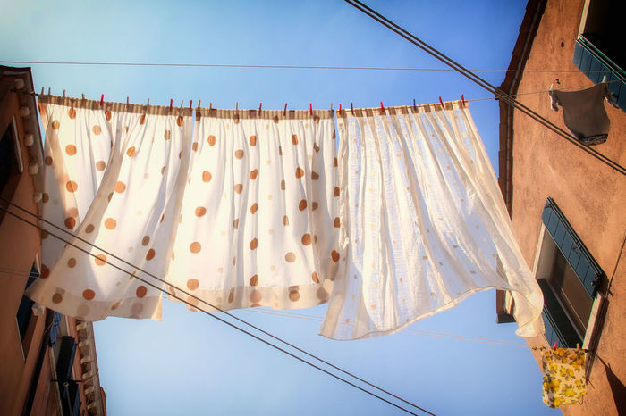 Blue Clear Sky Clothline Curtains Day Hanging In A Row Low Angle View No People Orange Outdoors Sky Sunlight Venice