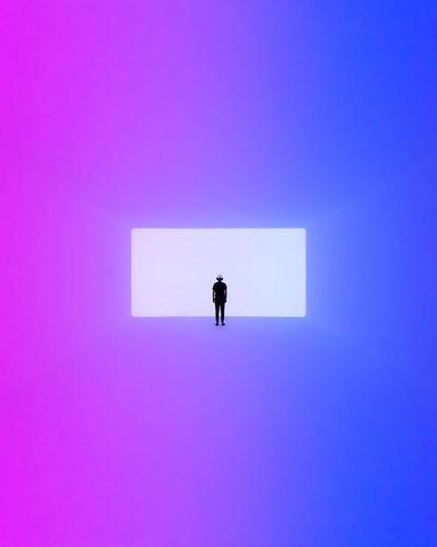 Full length of man against blue background