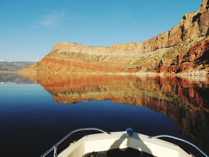 Reflection Flaming Gorge, Utah Lake Landscape Bluewater Lake Redrock Rockwall Beauty In Nature Outdoors Waterphotography Boating Time Fishingtrips Landscape_photography Sky Transportation Boat