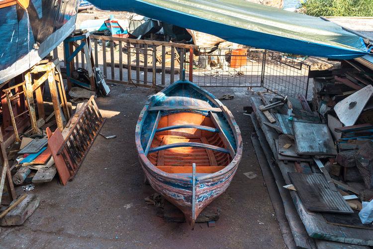 High angle view of boat at junkyard