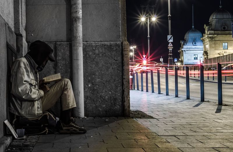 Man on street at night