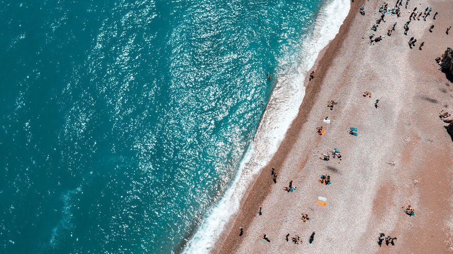 Beach Beauty In Nature Blue Day Drone çekim High Angle View Holiday Land Leisure Activity Nature Outdoors Real People Relaxation Sand Scenics - Nature Sea Summer Sunlight Trip Turquoise Colored Vacations Water