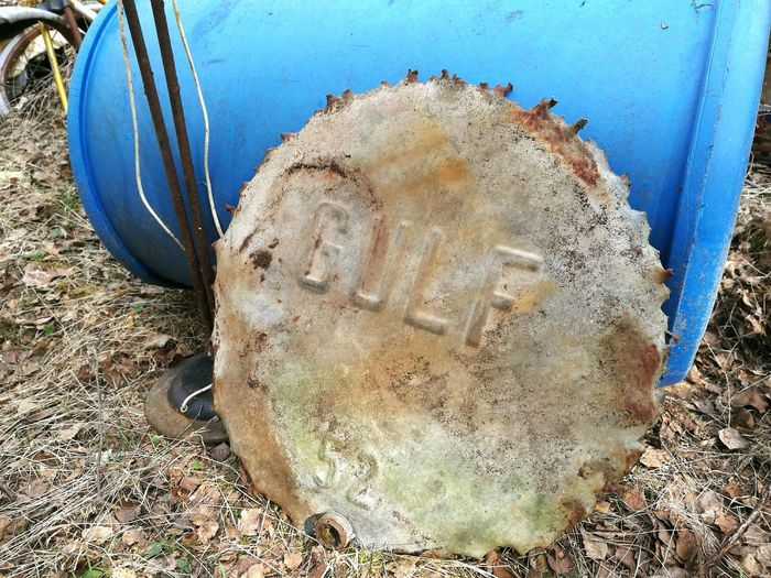 Vintage GULF oil barrel top or bottom cut found in forest Vintage Forest Find Gulf Oil Barrels Oil Sign Barrel.
