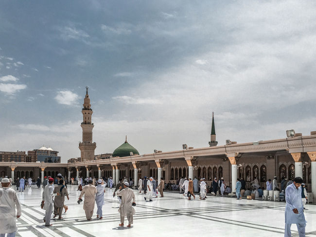 Architecture Masjidil Nabawi Madinah Adult Architecture Building Exterior Built Structure City Crowd Day Green Dome Islamic Architecture Large Group Of People Men Mosque Outdoors People Real People Sky Tourism Travel Destinations Walking Women