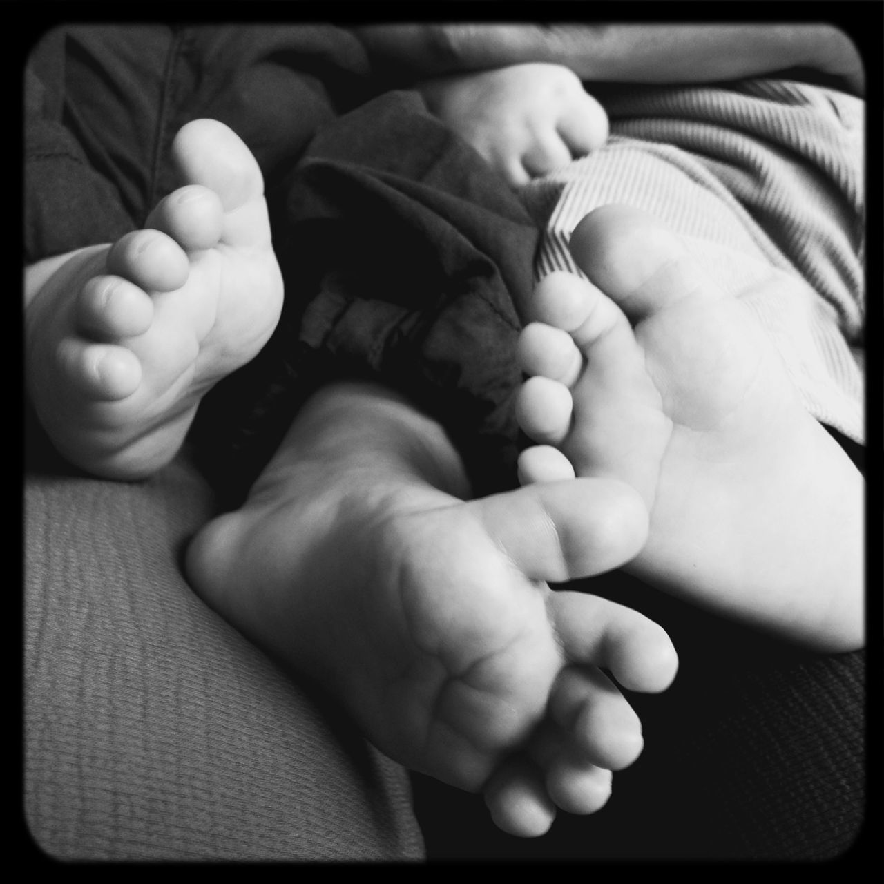 baby, newborn, babyhood, togetherness, fragility, innocence, bonding, love, childhood, beginnings, human hand, care, human body part, new life, indoors, barefoot, sole of foot, family with one child, family, close-up, father, real people, men, black background, day, adult, people