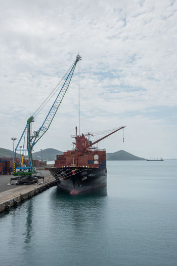 NOUMEA, NEW CALEDONIA-NOVEMBER 25,2016: Shipyard, nautical vessel, crane and commercial dock in Noumea, New Caledonia. Gantry Cranes Noumea Cargo Container Cloud - Sky Commercial Dock Crane Crane - Construction Machinery Day Freight Transportation Harbor Industrial Equipment Industry Mode Of Transport Nature Nautical Vessel New Caledonia Outdoors Pacific Ocean Sea Ship Shipping  Shipyard Transportation Water Waterfront