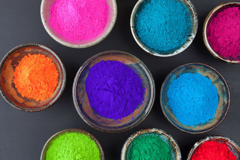 Directly above shot of colorful powdered colors on table