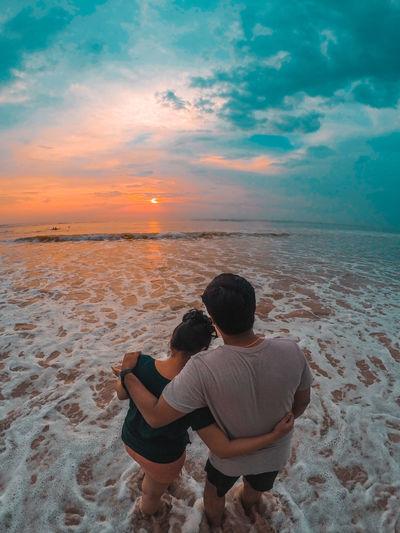 Indian couple enjoying sunset on the goa beach