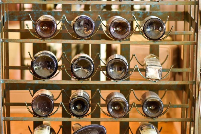 Close-up of wine bottles arranged on shelves