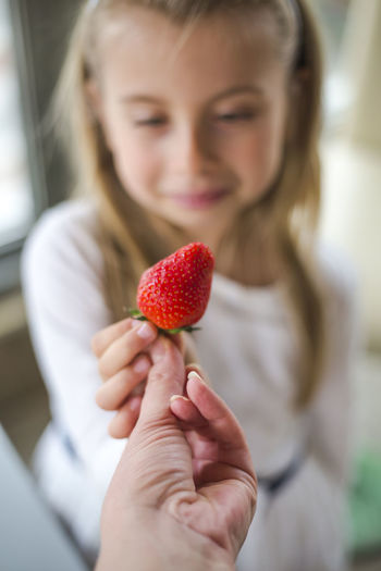Childhood Child Healthy Eating Holding One Person Fruit Food Wellbeing Focus On Foreground Berry Fruit Girls Food And Drink Females Real People Red Lifestyles Women Strawberry Freshness Front View Hand Hairstyle Innocence