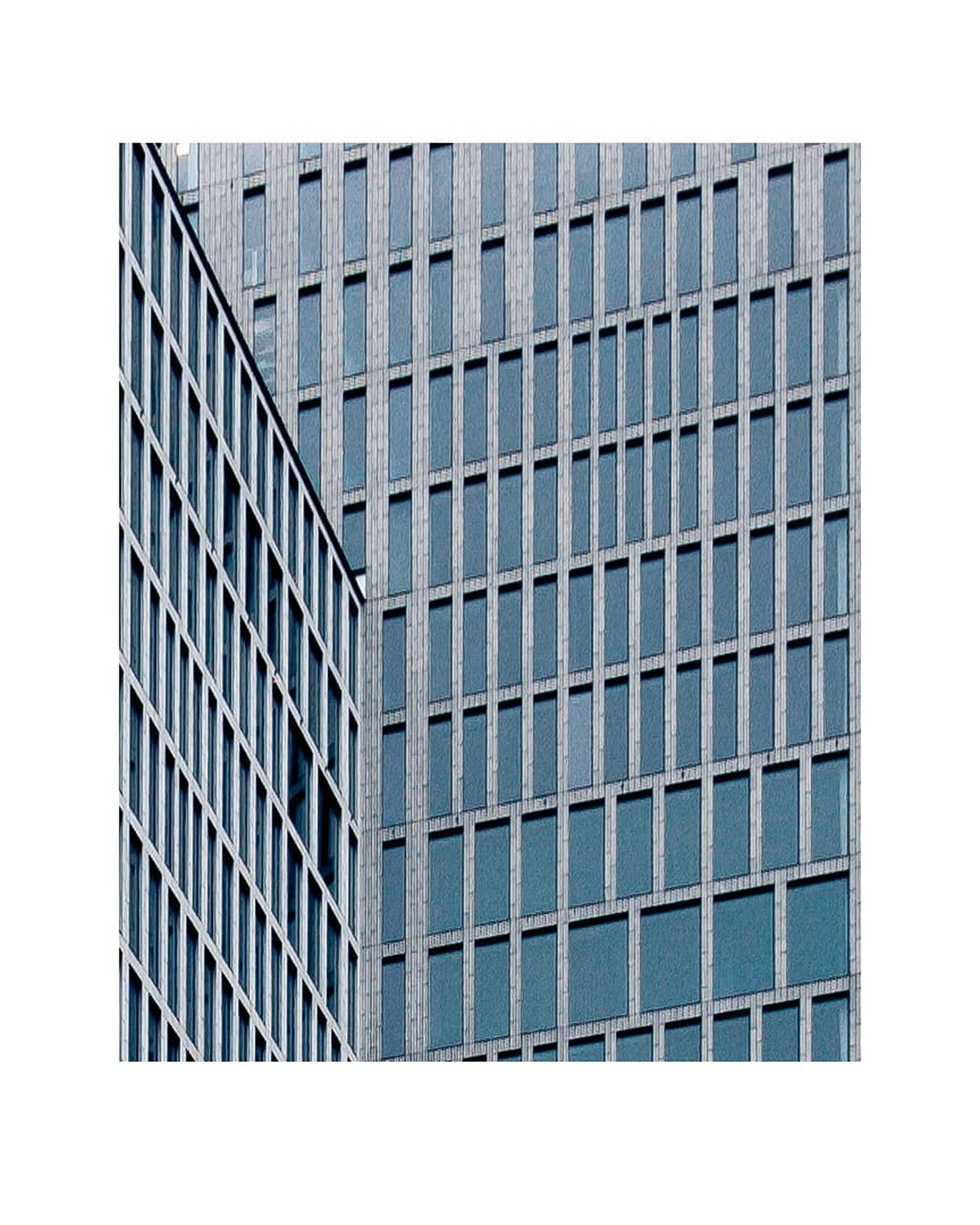 architecture, building exterior, building, built structure, modern, city, office building exterior, no people, window, clear sky, glass - material, pattern, office, sky, tall - high, outdoors, blue, cut out, reflection, control, skyscraper, place, location