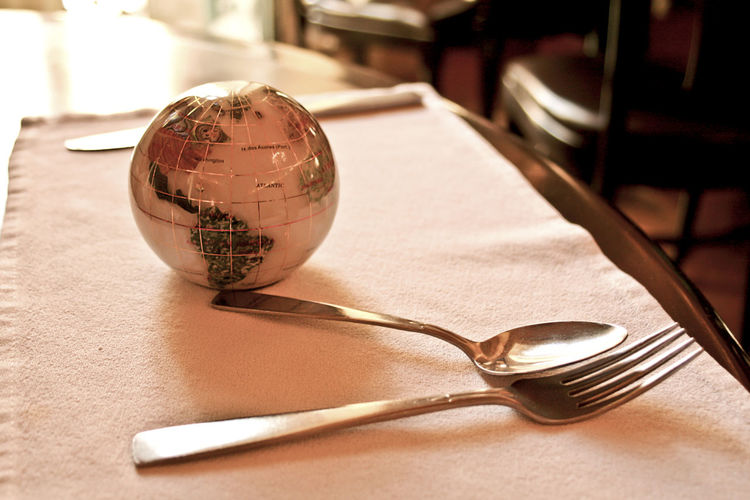 Close-up of disco ball and cutlery on table