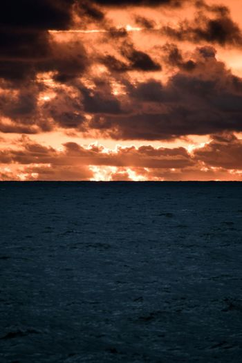 Where two halves meet. Sunset Sea Dramatic Sky Landscape Cloud - Sky Backgrounds Tourism Scenics Vacations Nature Beauty In Nature Outdoors No People Social Issues Tranquil Scene Tranquility Travel Red Water Awe