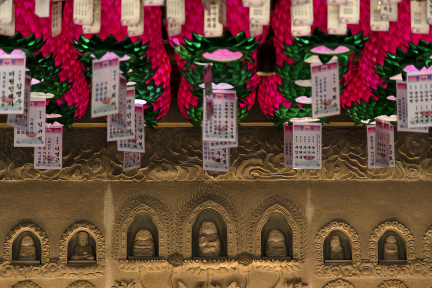 view at Bomunsa, a famous Buddhism temple in Seokmodo, Kimpo, Gyeonggido, South Korea Bomunsa Buddhism Temple Seokmodo South Korea South Korea🇰🇷 Architecture Arrangement Buddhism Building Exterior Built Structure Business Close-up Communication Container Day Focus On Foreground Hanging Illuminated In A Row Large Group Of Objects Nature No People Outdoors Red Religion Side By Side Temple Text