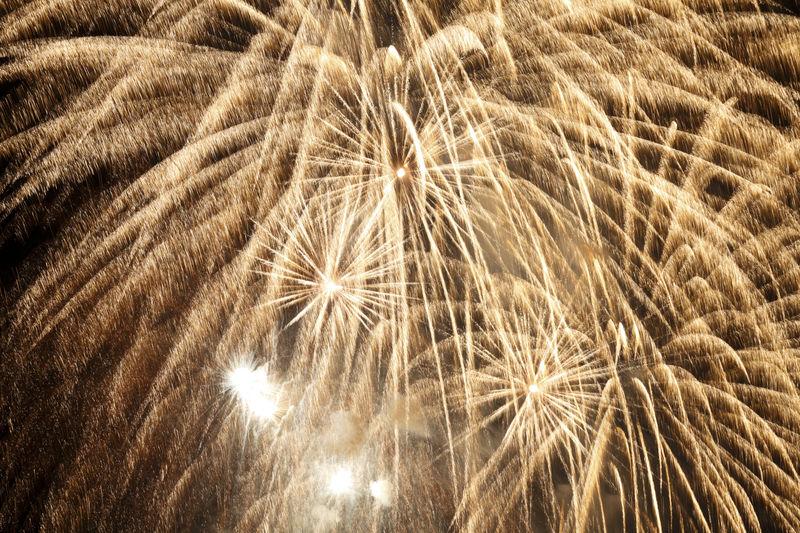 Full frame shot of illuminated fireworks against sky at night