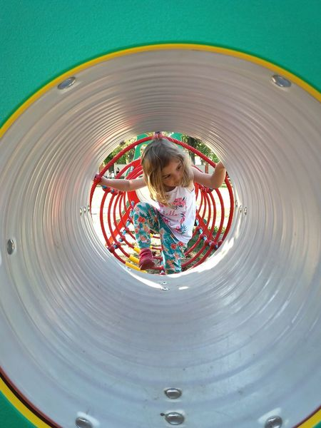 Childhood Playground Motion Outdoor Play Equipment Child Concentric Children Only Multi Colored People Playing One Person Round Shape Round Objects Inside Inside View Inside Out Inside Things Playground Equipment Playtime Little Girl Coming Out Coming In Coming Closer Kids Playing Playground Fun