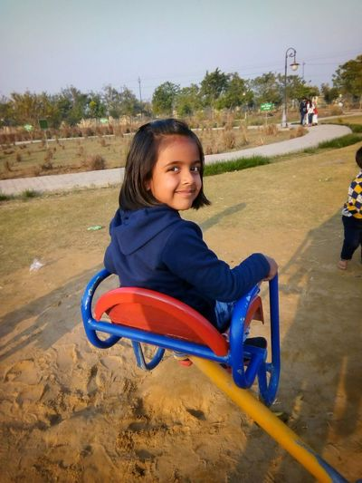 Girl sitting in playground