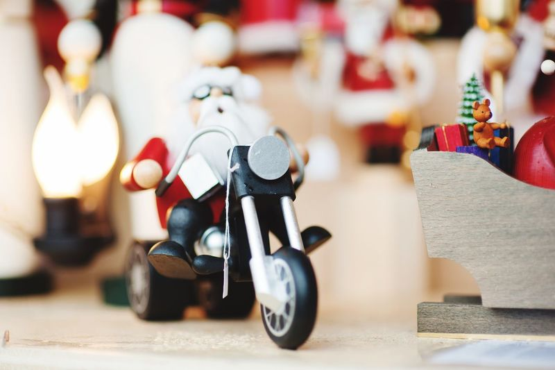 festive Christmas decorations No People Toy Indoors  Still Life Creativity Focus On Foreground Close-up Large Group Of Objects Representation Choice Variation Christmas Art And Craft Scooter Arrangement Transportation Figurine  Table Holiday