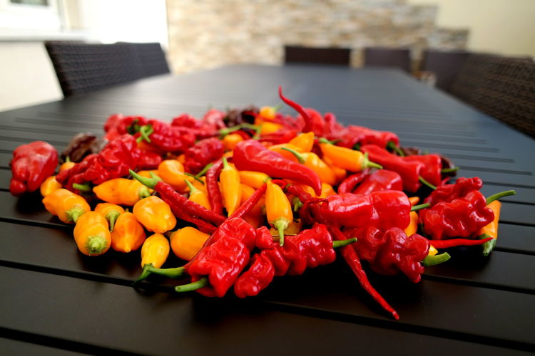 Close-up of chilies on table