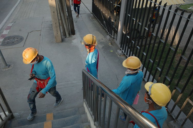 High angle view of people working on railing