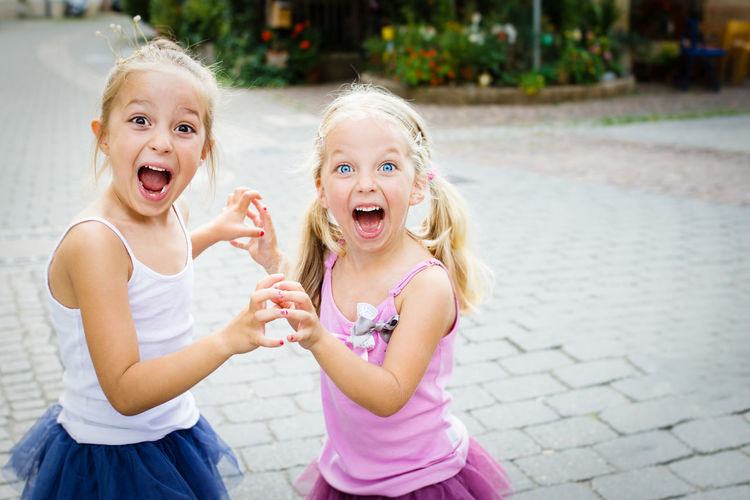 Portrait of happy girls playing