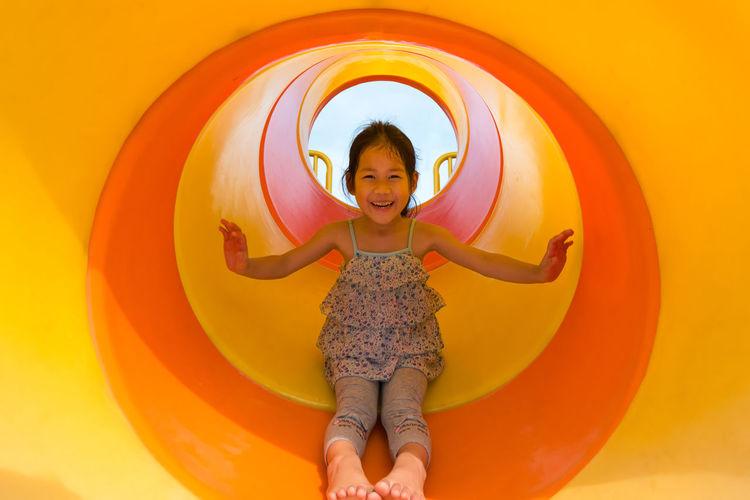Portrait of happy girl in slide