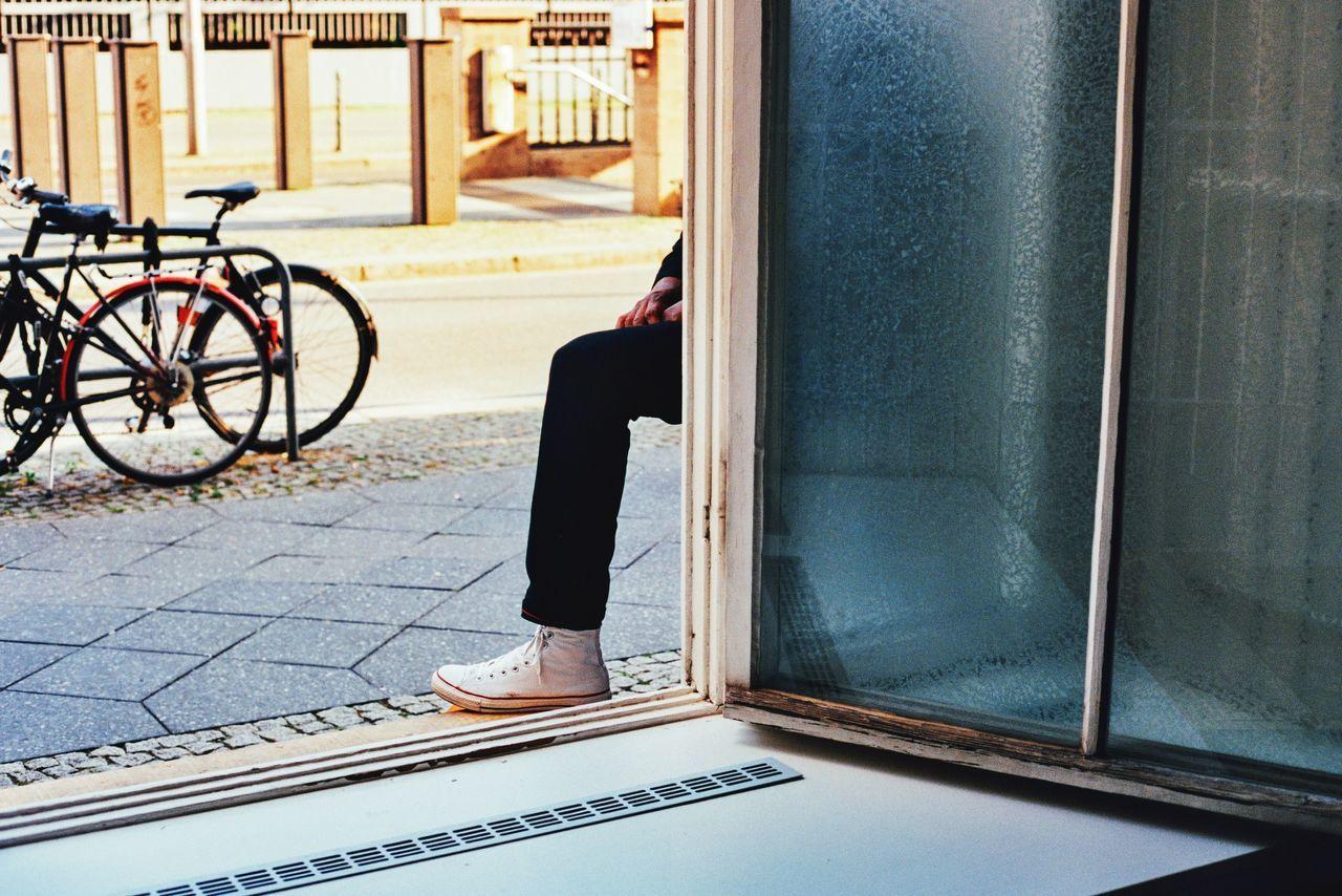 Man leg on doorway by sidewalk