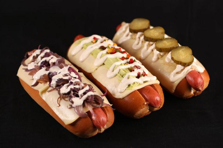 Close-up of hot dog against black background