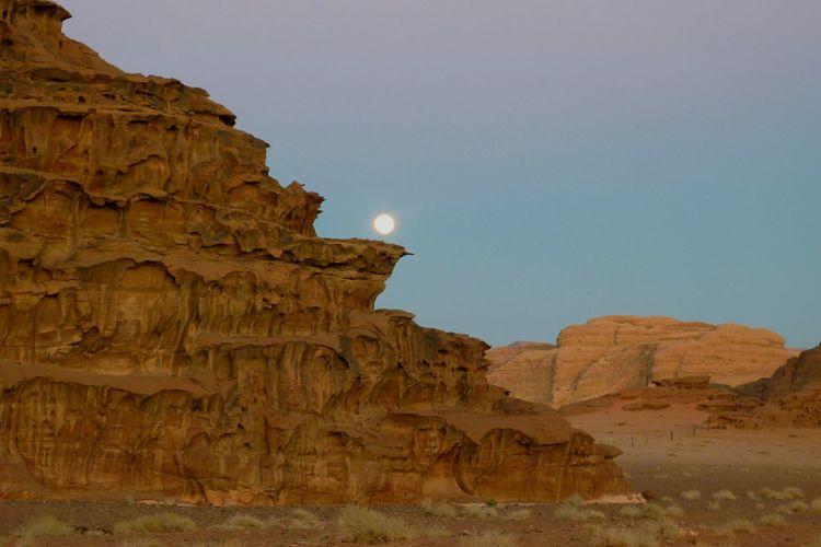 Moonrise over wadi rum, jordan