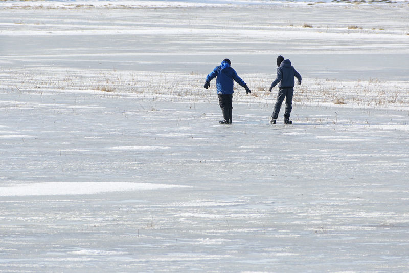 Full length of people walking on beach