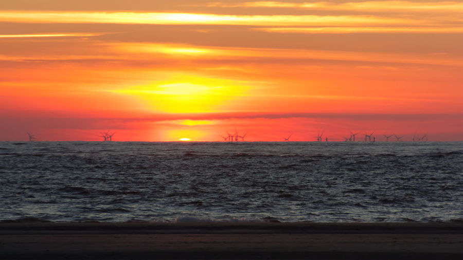 Beach Beauty In Nature Cloud - Sky Dramatic Sky Horizon Horizon Over Water Idyllic Landscape Nature No People Northsea Offshore Windpark Orange Color Outdoors Romantic Sky Scenics - Nature Sea Seascape Sun Sunset Tranquil Scene Tranquility Water Wave