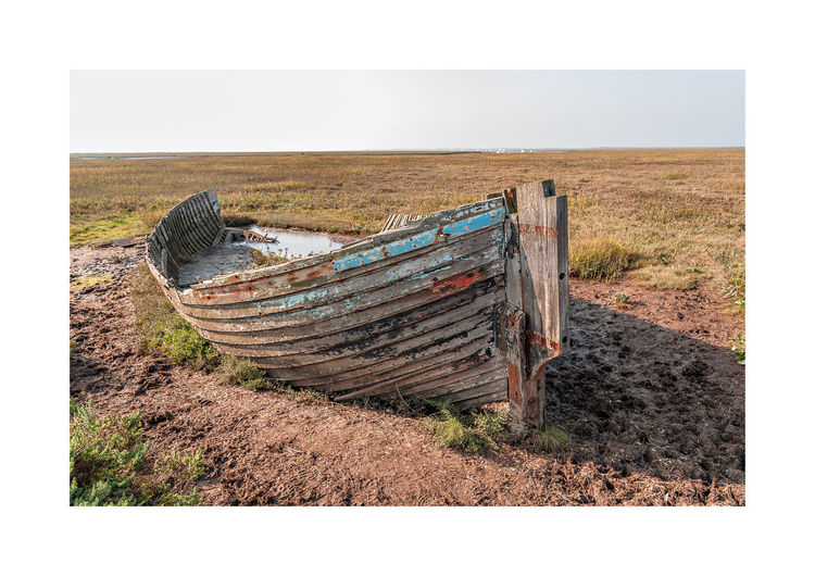 rusty boat Abandoned Beach Beauty In Nature Blakeney National Nature Reserve Boat Clear Sky Damaged Day Desolate Field Grass Landscape Nature Nautical Vessel No People Outdoors Rusty Sand Sky Wood - Material Wooden Texture