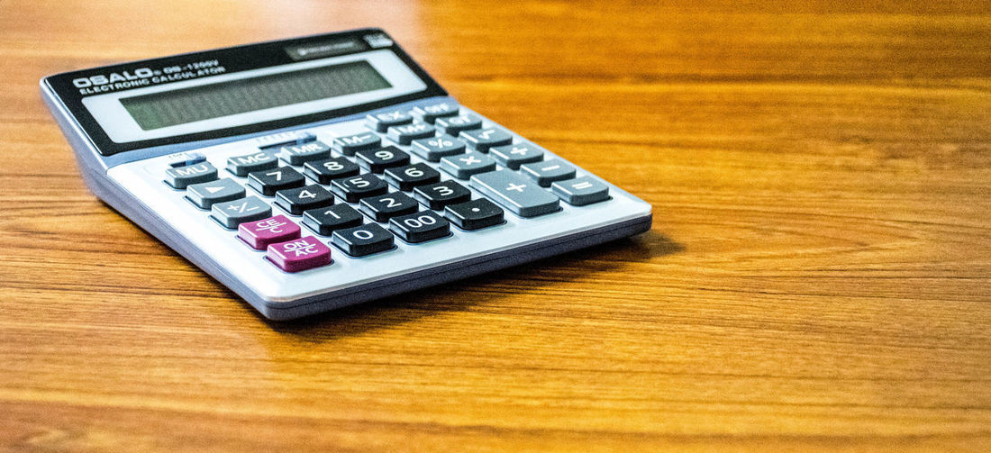 Business Calculator Close-up Corporate Business Counting Day Dividing Finance Growth Indoors  Keypad Mathematics No People Number Science Selective Focus Single Object Table Technology Wood - Material