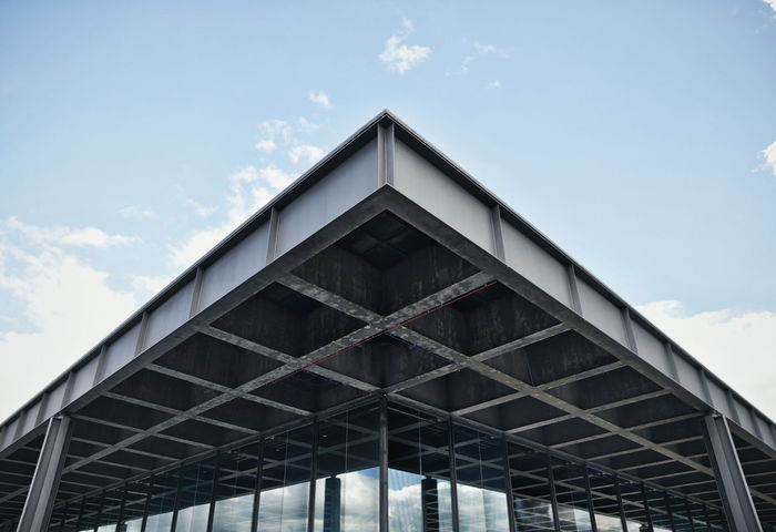 Neue Nationalgalerie by Ludwig Mies van der Rohe Architectural Feature Architecture Berlin Building Exterior Engineering Geometry Low Angle View Mies Van Der Rohe Modern Neue Nationalgalerie Structure Symmetry Capture Berlin Discover Berlin