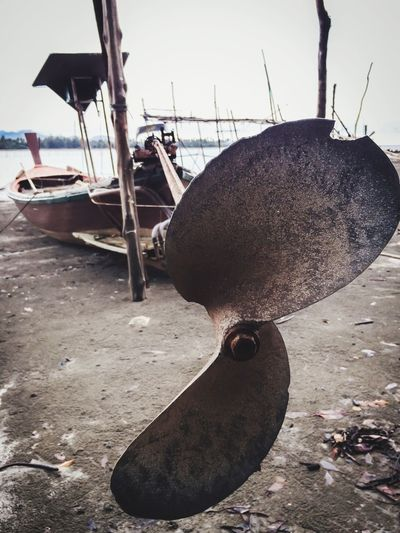 Boat propeller Boat Propeller Water Nautical Vessel No People Transportation Beach Nature Day Mode Of Transportation Sea Land Sky Sand Outdoors Fishing Industry