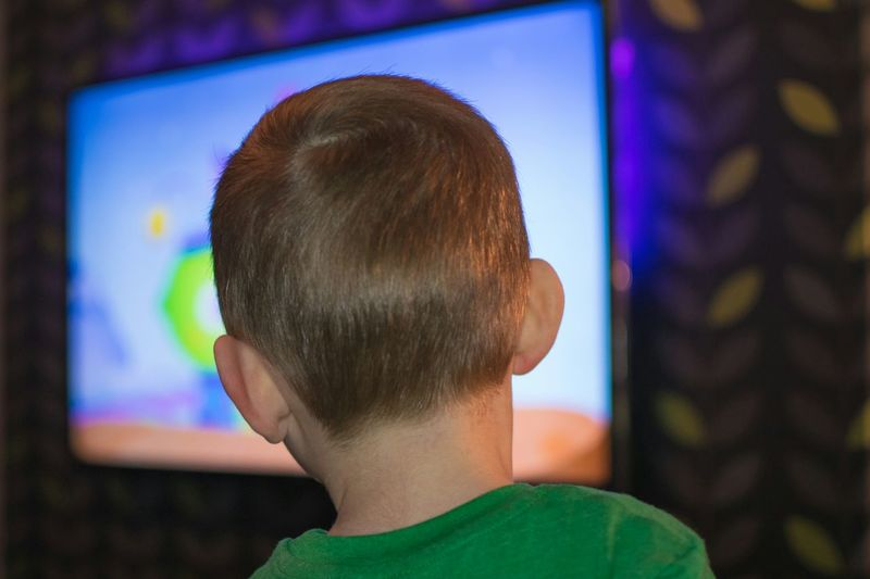 Headshot One Person Portrait People Close-up Child Kid Tv Television Green Night Indoors  Backlit Wall Watching Cartoon