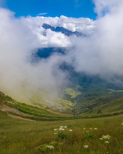 Landscape of the caucasus mountains, clouds descend from the peaks.