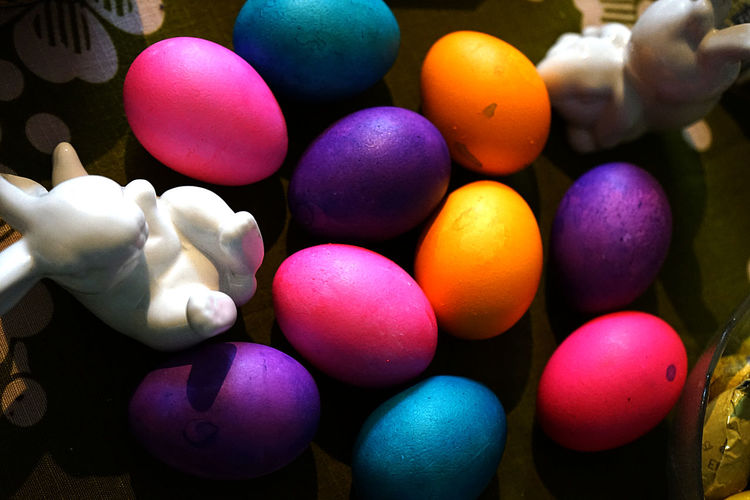 Egg Multi Colored Easter Easter Egg Celebration Holiday Food Indoors  Large Group Of Objects Food And Drink Human Hand Close-up Hand One Person Human Body Part Focus On Foreground Art And Craft Choice Finger Purple Easter Eggs