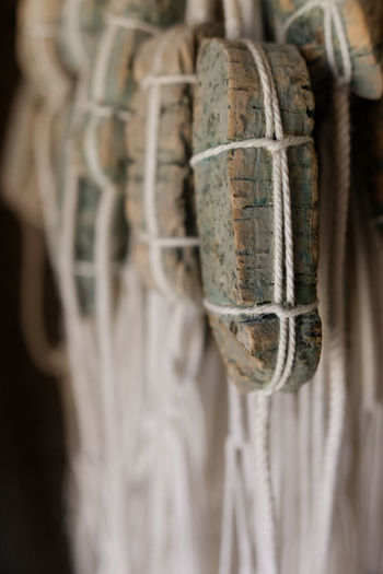 Close-up of wood hanging from rope