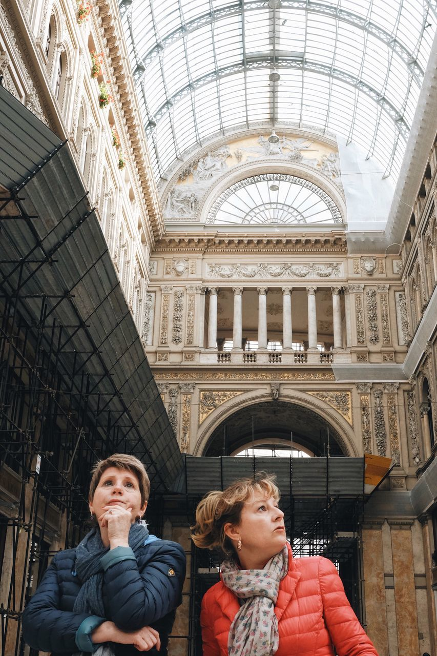 architecture, real people, built structure, two people, lifestyles, day, low angle view, young women, young adult, men, togetherness, travel destinations, headshot, indoors, building exterior, city, adult, adults only, people