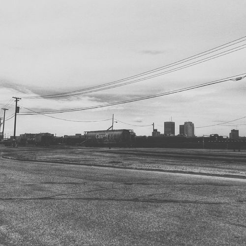 """Spent a lot of time searching for reasons and answers..but you can't find what's not there...."" (05/26/2013) Trainyard Blackandwhite Winnipeg"