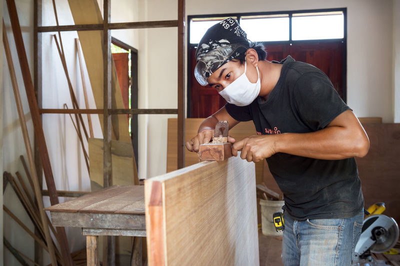Adult Adults Only Asian  Carpenter Day Design Holding Home Indoors  Interior Job Man Men Object Only Men People Planer Professional Occupation Skill  Studio Tool Working Workshop Young Adult