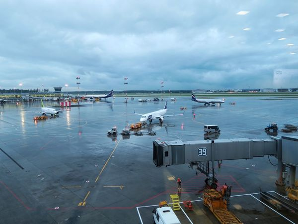 Airplane Airport Runway Transportation Airport Cloud - Sky Sky Passenger Boarding Bridge Air Vehicle Runway Commercial Airplane Airplane Wing RainyDay Rainy Rainy Days Rainy Day Rain Travel