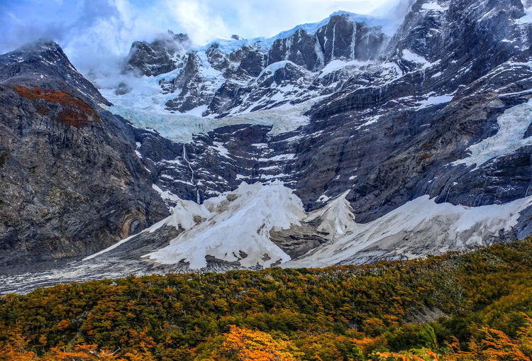 View of the French Valley during the full blown colors of Autumn #fujifilmxt2 French Valley Patagonia Chile Travel Photography Beauty In Nature Cloud - Sky Cold Temperature Day Environment Formation Landscape Mountain Mountain Peak Mountain Range Nature No People Outdoors Range Scenics - Nature Snow Snowcapped Mountain Tranquil Scene Travel Destinations Waterfall Winter